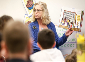 Rep. Gail Mooney reading Grace for President at her local elementary school.